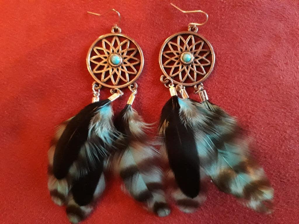 shaman magic earrings feathers